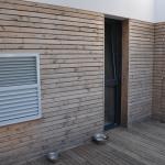 grille extérieure pompe à chaleur amzair maison d'architecte